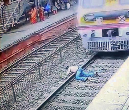 今にも電車に轢かれそうな自殺志願者