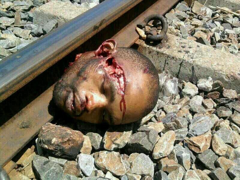 電車に吹っ飛ばされて頭部のみになった飛び込み自殺志願者